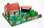 Petite ferme en bois et plastique avec ses 12 animaux